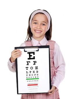 Beautiful child holding a vision exam chart