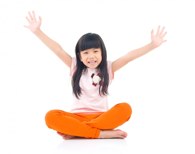 Beautiful child sitting on the floor and laugh