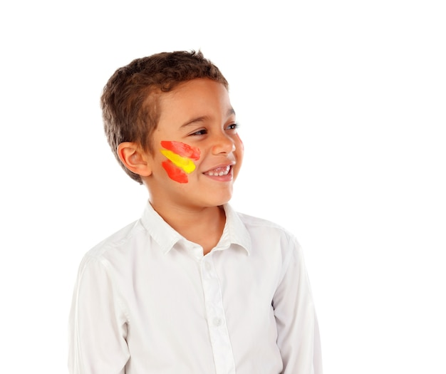Beautiful child with spanish colors flag painted on his face