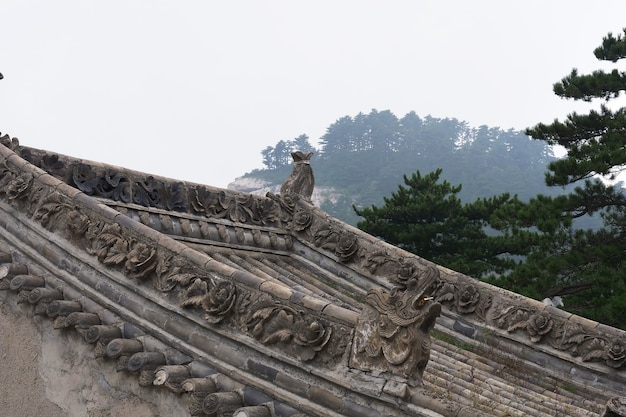 Beautiful chinese ancient traditional roof with stone carving in sacred taoist mountain mount huashan, popular touristic place in china