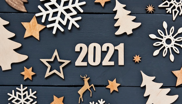 The beautiful christmas background with a lot of small wooden decorations