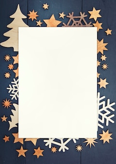 The beautiful christmas background with lots of small wooden decorations