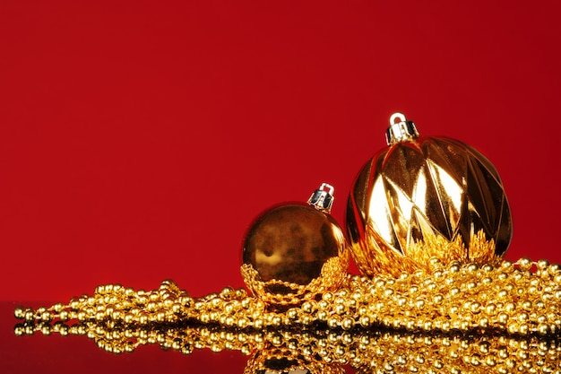 Beautiful christmas bauble close up on a dark red background
