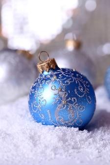 抽象的な光沢のある背景に美しいクリスマスの構成