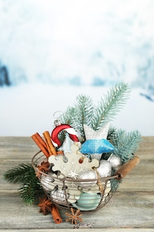 Beautiful christmas composition with silver walnuts, on wooden table