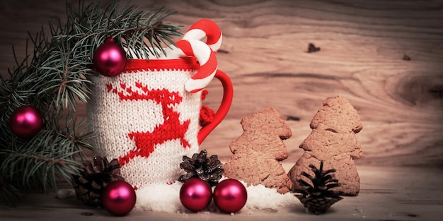 Beautiful christmas cup and gingerbread man on wooden table.photo with space for text