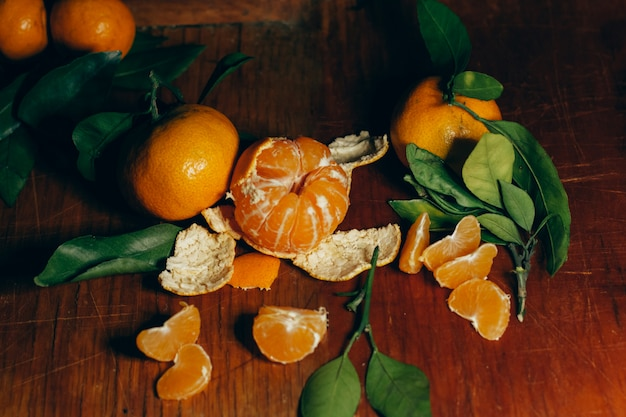 Beautiful christmas decoration with tangerines in the night light garlands. citrus still life. the symbol of the new year