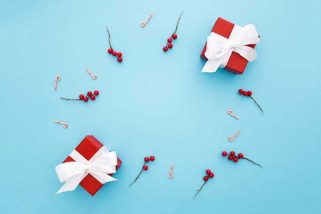 Beautiful christmas gifts on a light blue background
