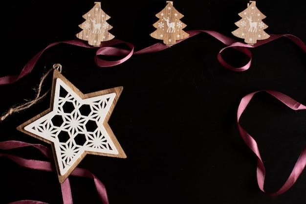 Beautiful christmas golden silver deco baubles on dark black background.