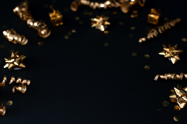 Beautiful christmas golden silver deco baubles on dark black background.