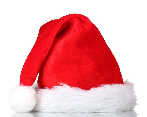 白い壁に分離された美しいクリスマス帽子