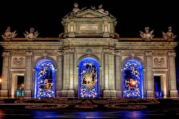 Beautiful christmas illumination at the monument of the puerta de alcala in madrid