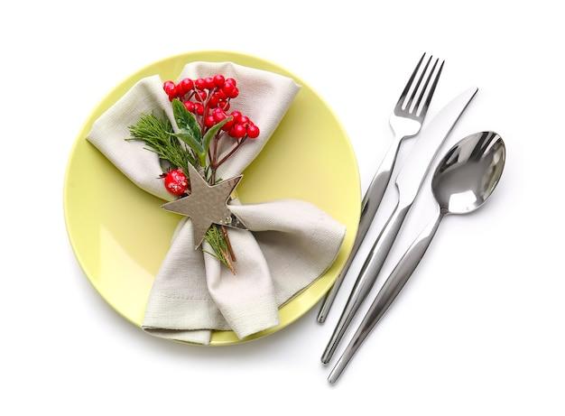 Beautiful christmas table setting with mistletoe isolated