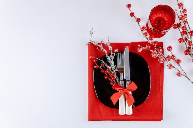 Beautiful christmas table setting with red berries. copy space, top view.