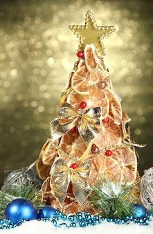 Beautiful christmas tree of dry lemons with decor, on shine wall