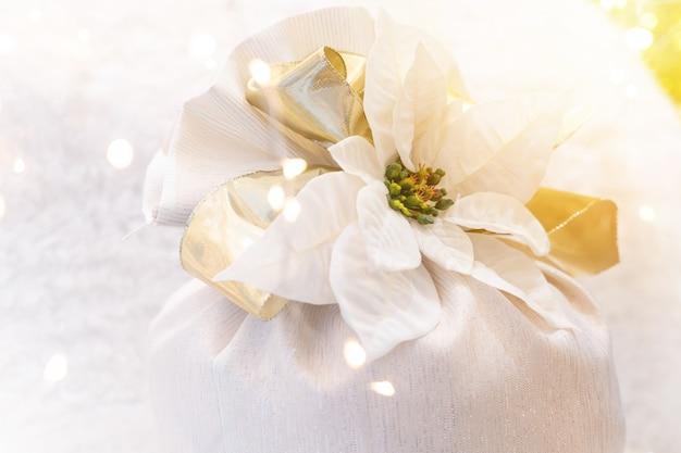 Beautiful christmas white flower ribbon with bokeh