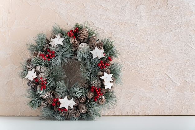 Beautiful christmas wreath on light background. copy space. winter holiday pattern.