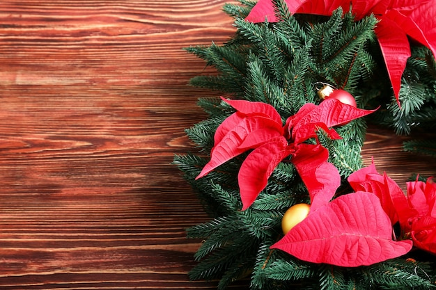 Beautiful christmas wreath on wooden table, closeup