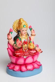 Beautiful clay idol of hindu goddess lakshmi or laxmi on white