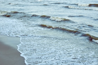 Beautiful clear water lapping on the shore