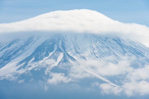 Beautiful closeup of mount fuji with snow and hat shaped cloud yamanashi japan