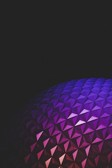 Beautiful closeup shot of epcot taken at night with amazing colored textures and dark background