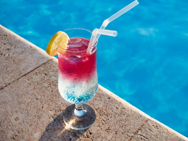 Beautiful  cocktail near swimming pool. view from above, close-up. concept of leisure and travel