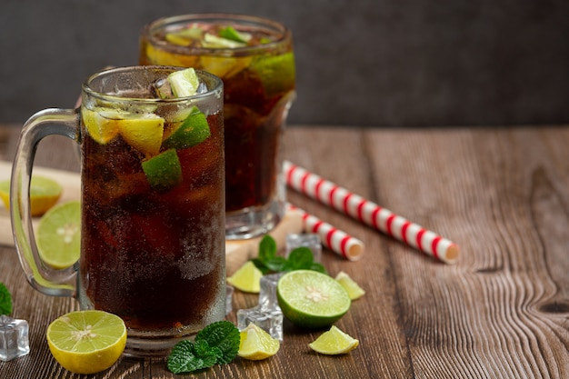 Beautiful cold drink of cola with ice cubes