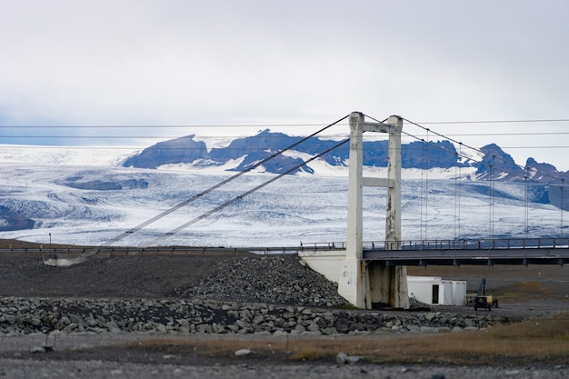 Beautiful cold landscape of jokulsarlon glacier lagoon, iceland, during the summer with the bridge as a background