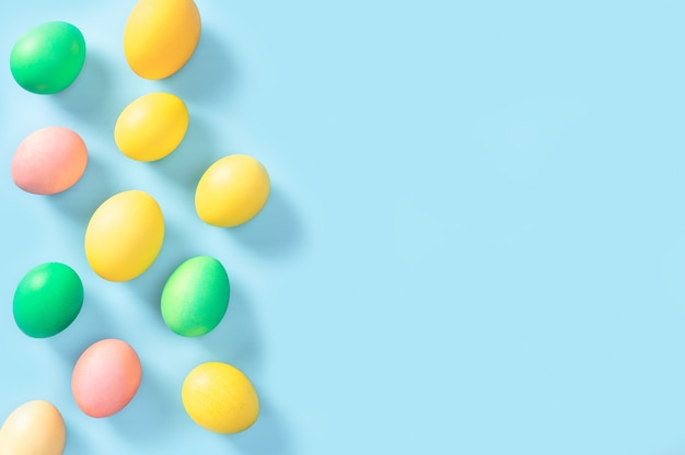 Beautiful colorful easter eggs isolated on blue background. happy easter. congratulatory easter background.