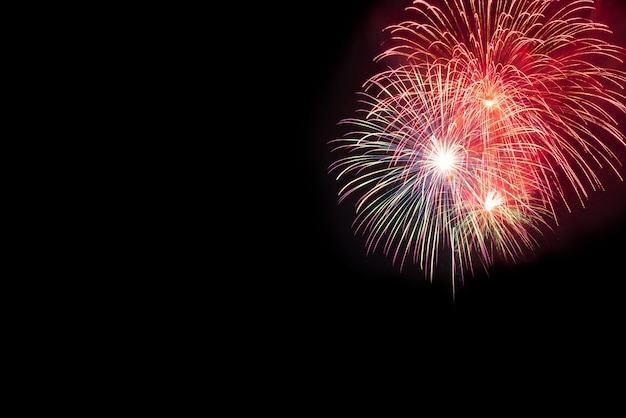 Beautiful colorful fireworks display for celebration on black background.