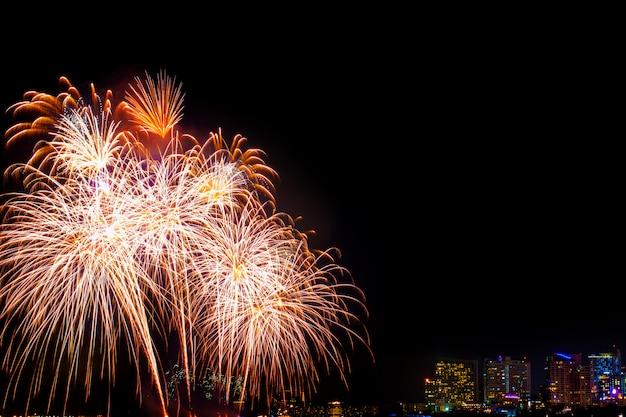 Beautiful colorful fireworks display on the sea beach