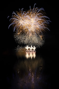 Beautiful colorful fireworks with reflections in water. brno dam, the city of brno-europe. internati
