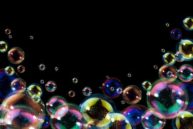 Beautiful of colorful soap bubbles float on black background.
