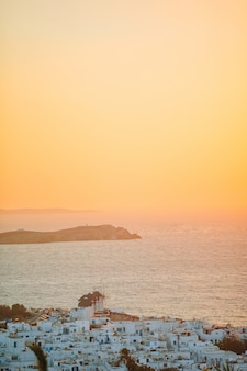 Beautiful colorful sunset of amazing greek town mykonos