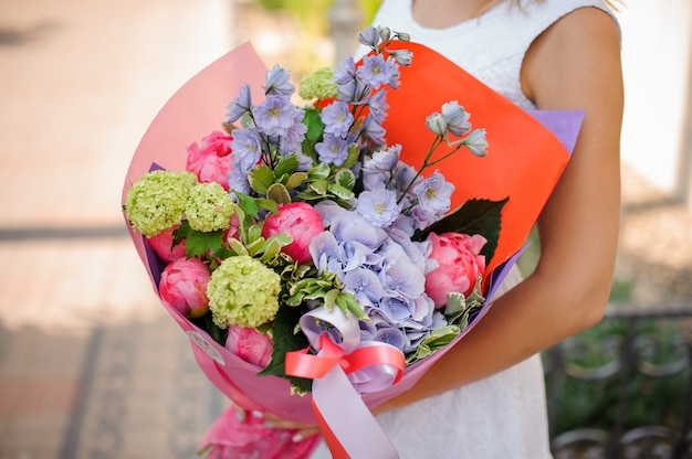 Beautiful colorful wedding bouquet in woman hands
