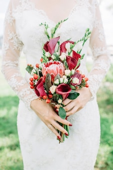 Beautiful colorful wedding bouquet in woman hands.