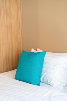 Beautiful and comfortable pillows decoration on bed in bedroom