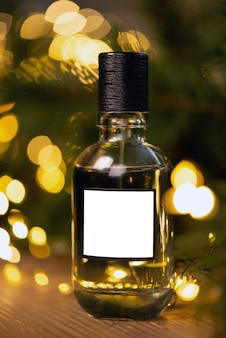 Beautiful composition of a bottle of perfume on a wooden table against the background