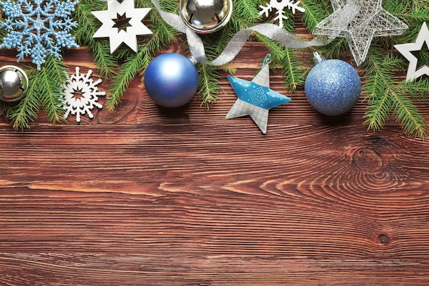 Beautiful composition of christmas decor on wooden surface