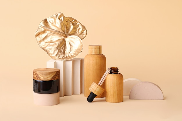 Beautiful composition from the cosmetics bottles and golden flamingo flower