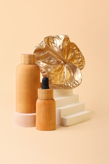 Beautiful composition from wooden cosmetics bottles and flamingo flowertrendy geometrical podiums