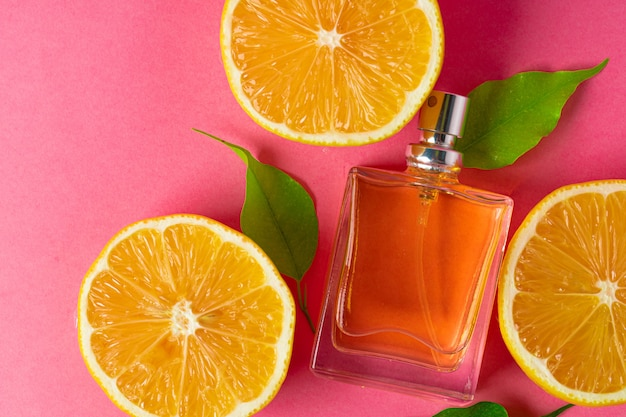 Beautiful composition with bottle of perfume and citrus fruits