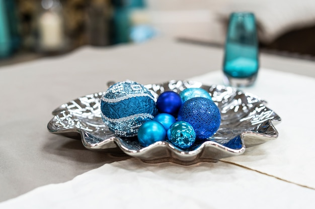 Beautiful composition with round blue christmas decorations