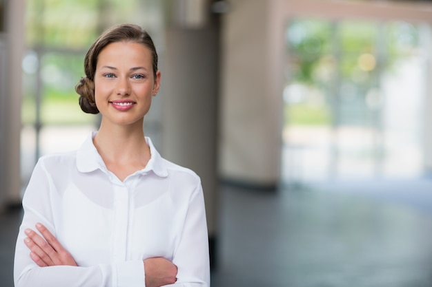 Beautiful and confident businesswoman with arms crossed
