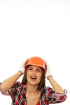 Beautiful confident woman with protective engineer hat