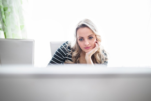 Beautiful contemplated woman in office