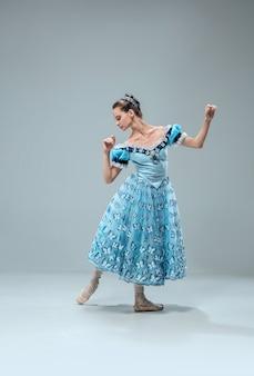 Beautiful contemporary ballroom dancer isolated on grey studio wall