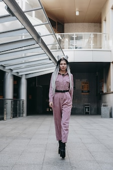 Beautiful cool girl with dreadlocks full length photo in the city  urban style
