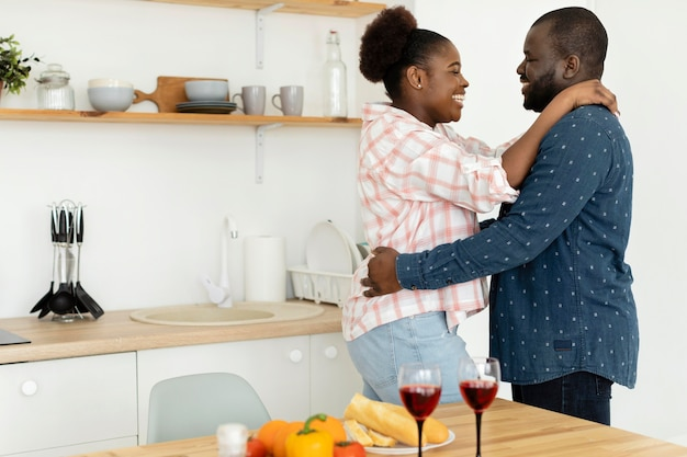 Beautiful couple being together in the kitchen